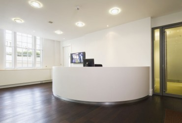 Reception+desk+2+made+from+corian+and+maple+for+Advent